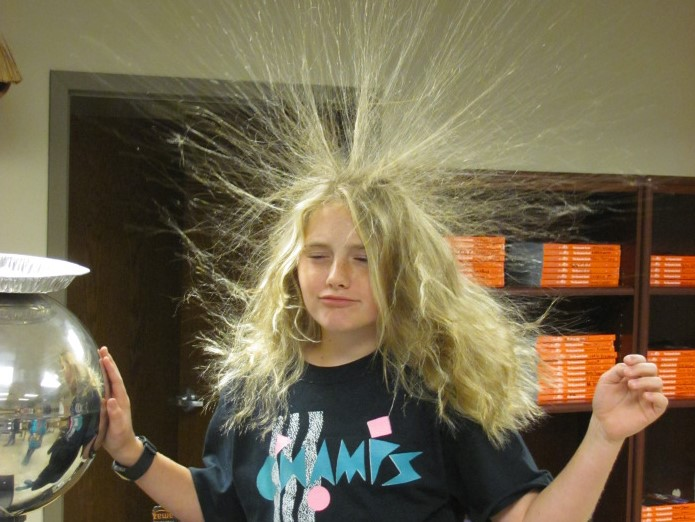 Student's hair stands straight up with static electricity