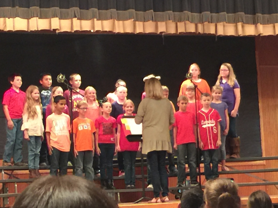NEs Choir Students Stand on Stage to Perform