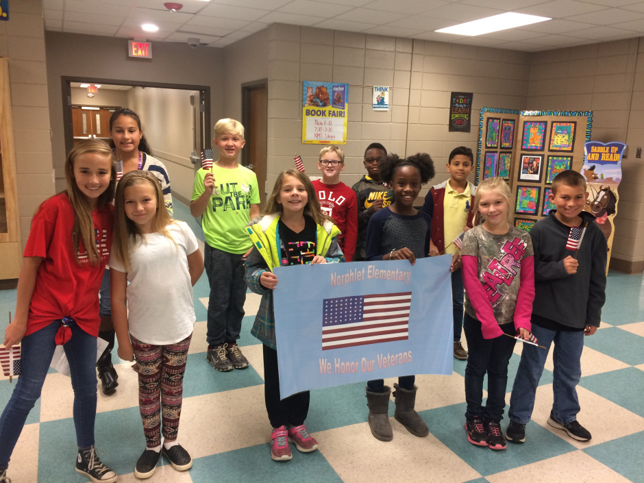 NES Students Hold Up Sign for Veterans