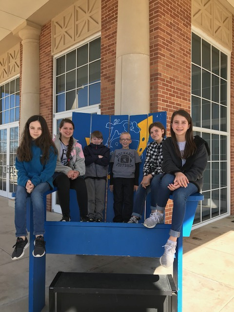 Norphlet Middle School 5th and 6th grade GT students Sitting in a Giant Blue Chair
