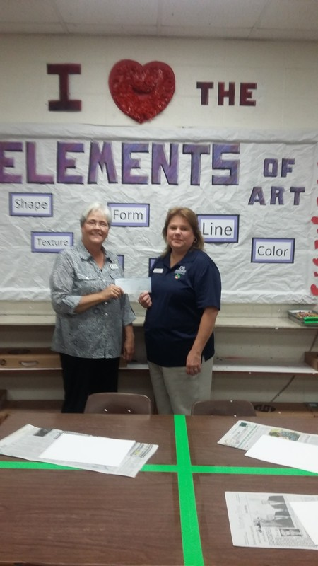 Cherrie Sweeney Presents a Check for the Arts to Lauralyn Ramsey