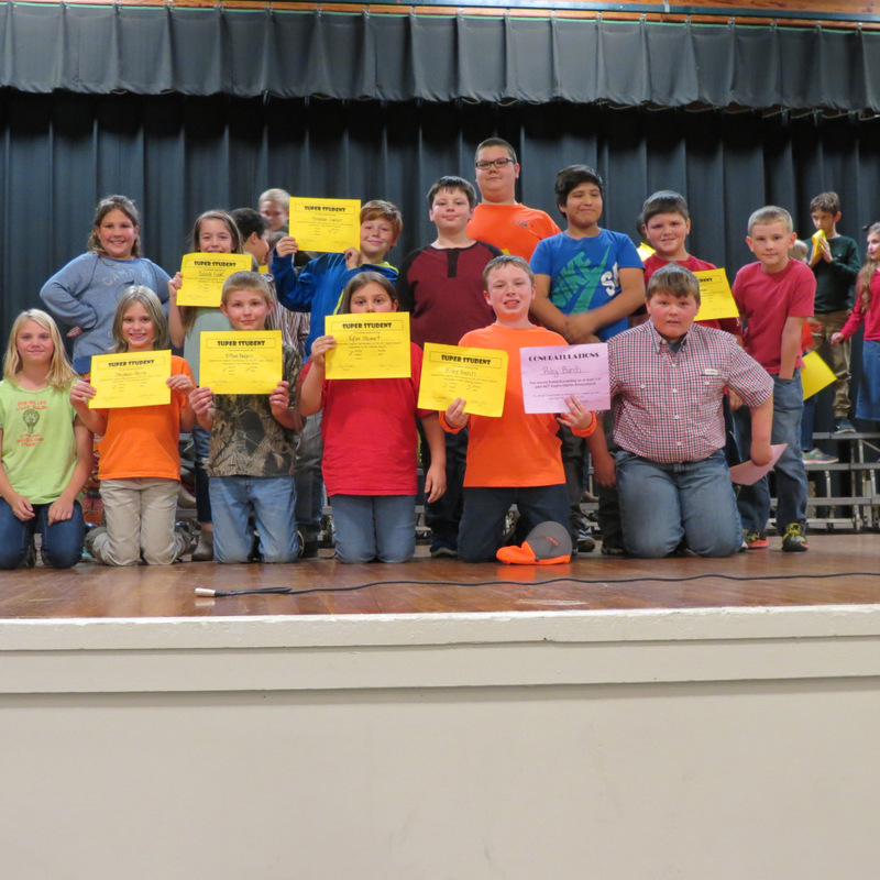 4th Graders Hold Up Their Awards