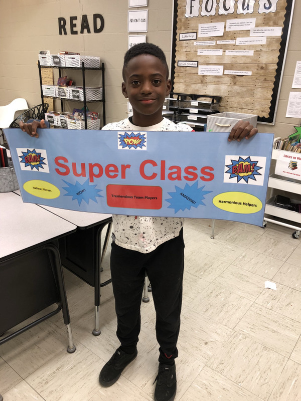 NES Student Holds Up Super Class Award