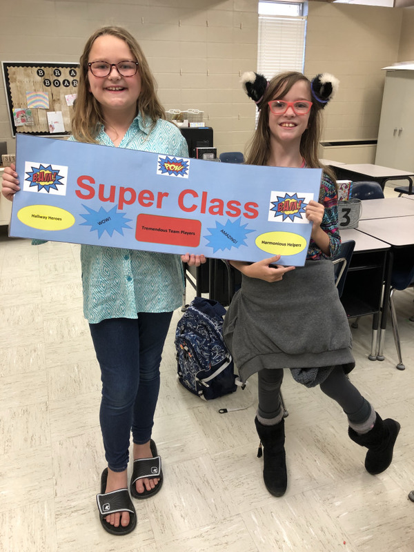Two NES Students Pose with Super Class Award