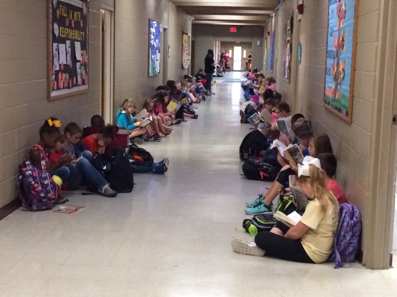 NES Super Kids Reading in the Hallway