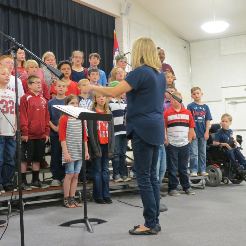 Choir Director Leads Students in a Song
