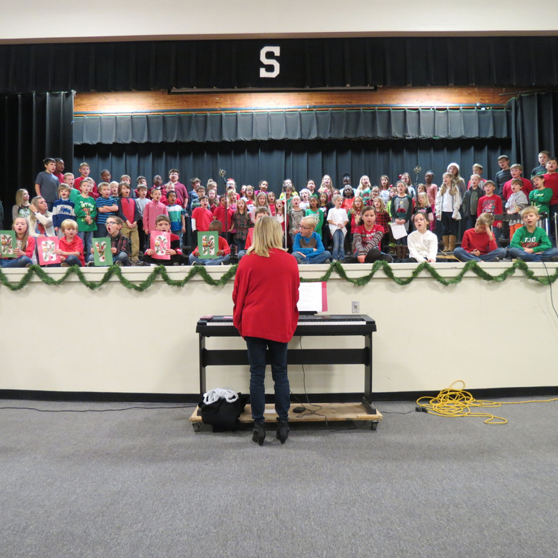 SES Choir Teacher Plays Music for the Program