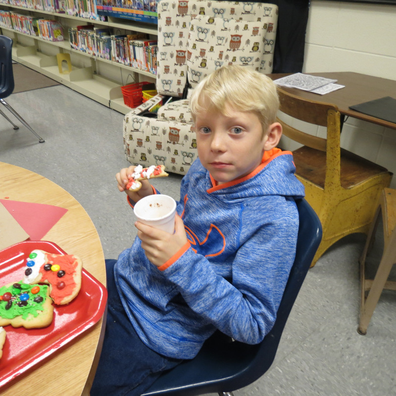 SES Student Eats a Candy Cane Cookie