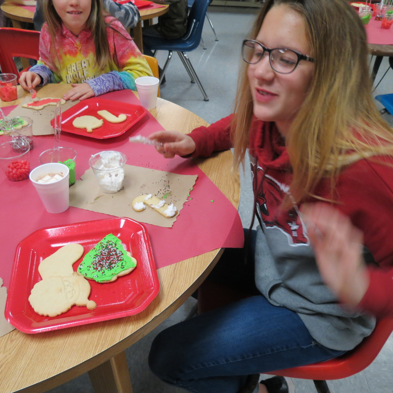 SES Student Works on Her Cookies