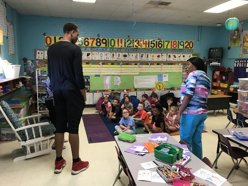 Pictures for the blog and website.  Daniel Gafford came to visit our elementary students.  He is a current Arkansas Razorback basketball player.  He graduated from El Dorado High School.
