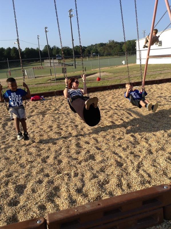 Smackover Preschool Students playing on the Swing Set