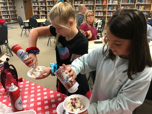 NMS Students putting Toppings on Their Ice Cream