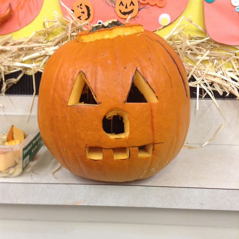 Smackover Preschool Students Carve a Pumpkin